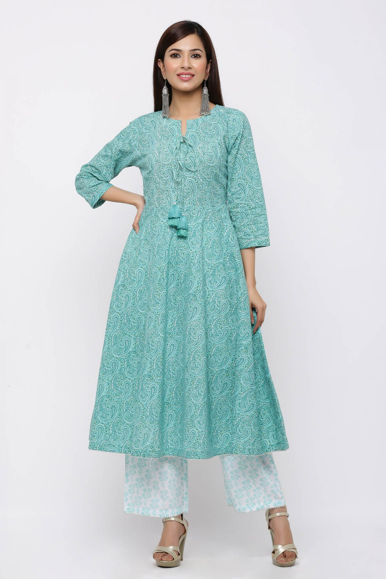 Turquoise printed kurta set with tassel detailing.
